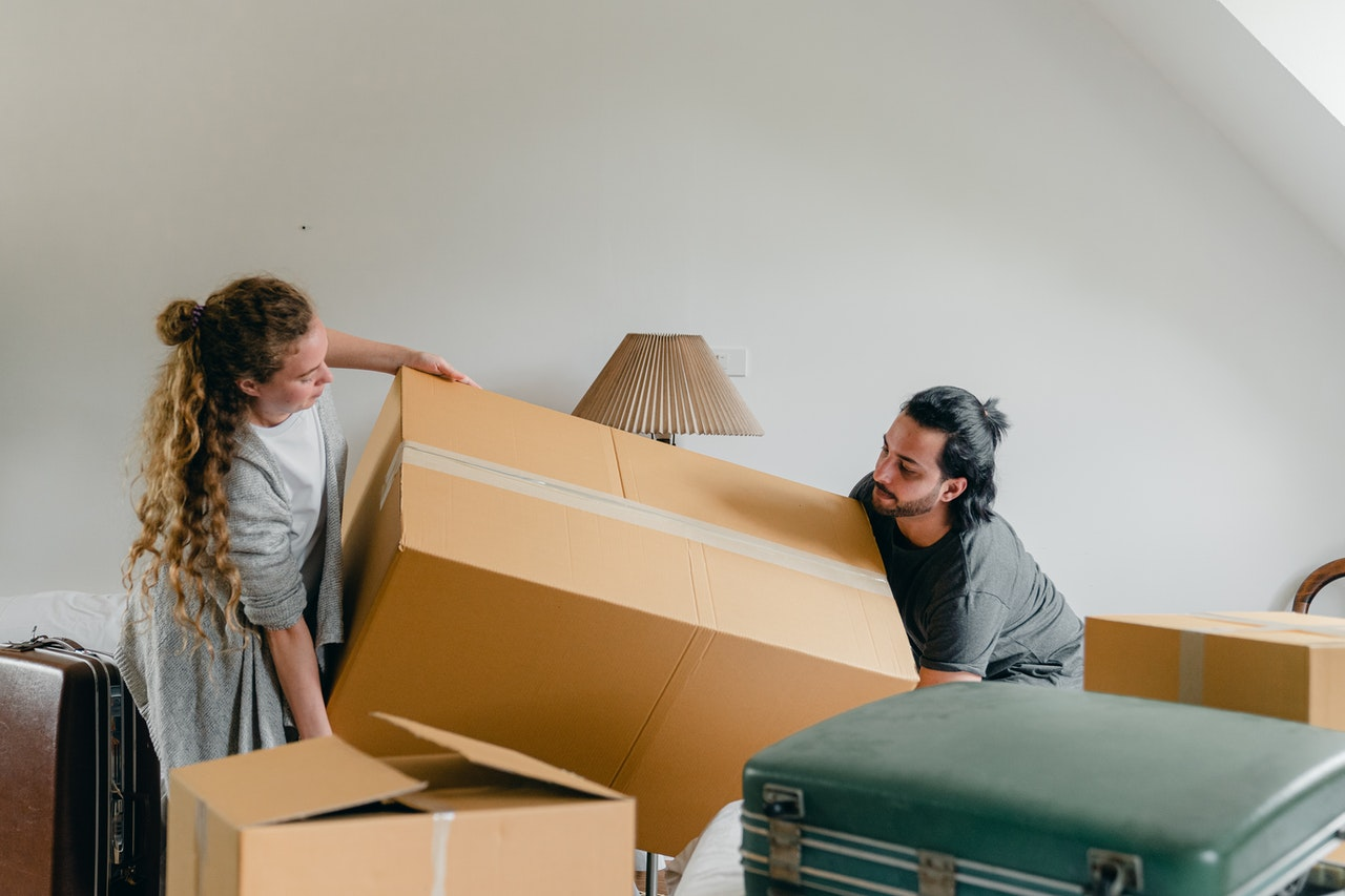Couple moving big boxes